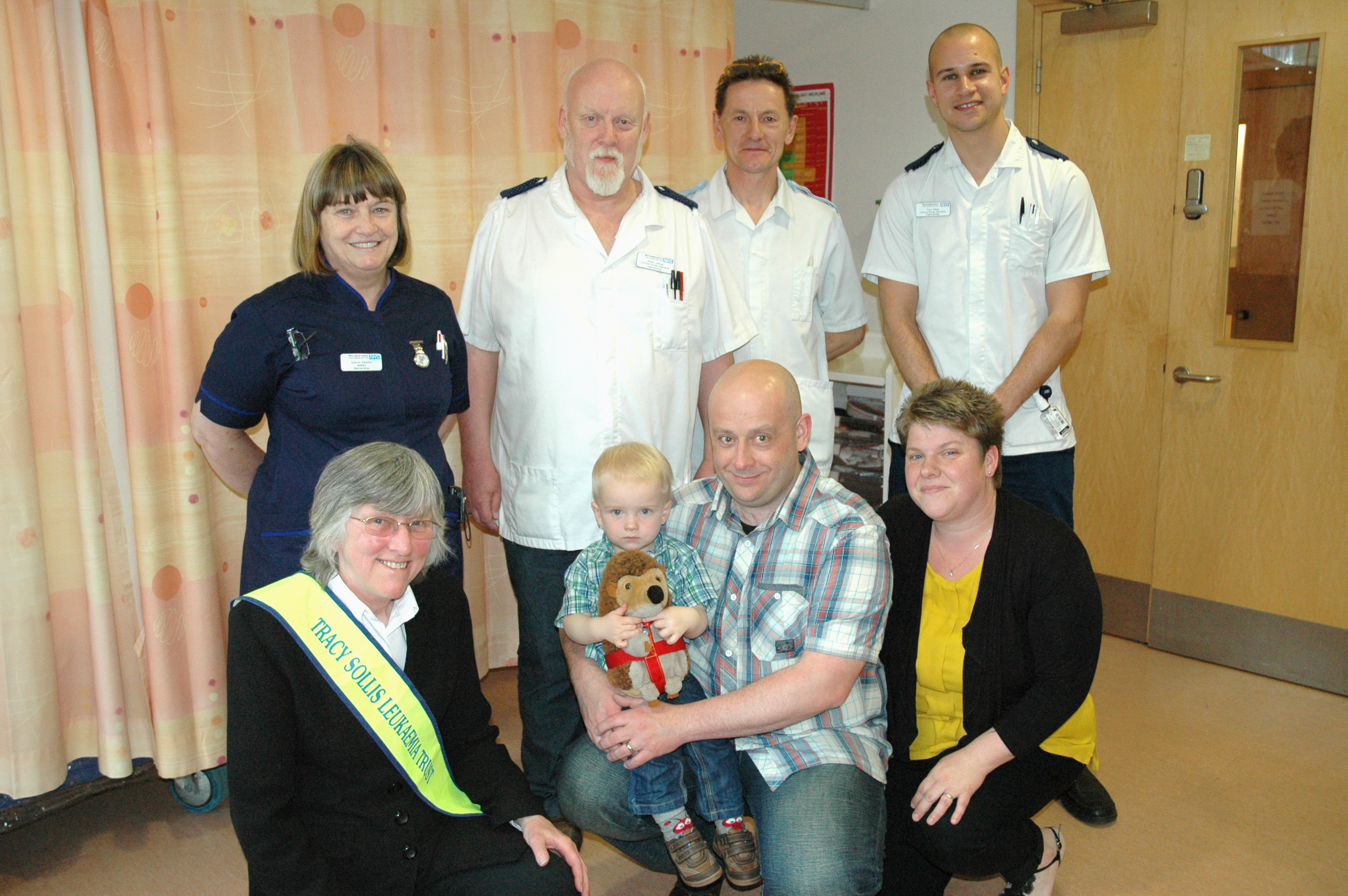 Tracy Sollis Trust donation - Glenis Adams, Pete James, Andy Wilce, Tom Rees, Sue Sollis, Antony, Donna and Oliver Fessey (1)