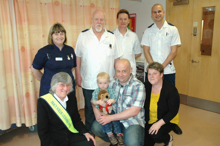 Tracy Sollis Trust donation - Glenis Adams, Pete James, Andy Wilce, Tom Rees, Sue Sollis, Antony, Donna and Oliver Fessey (1).jpg